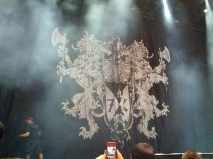 New curtain for the tour, says REV in the banner under the deathbat